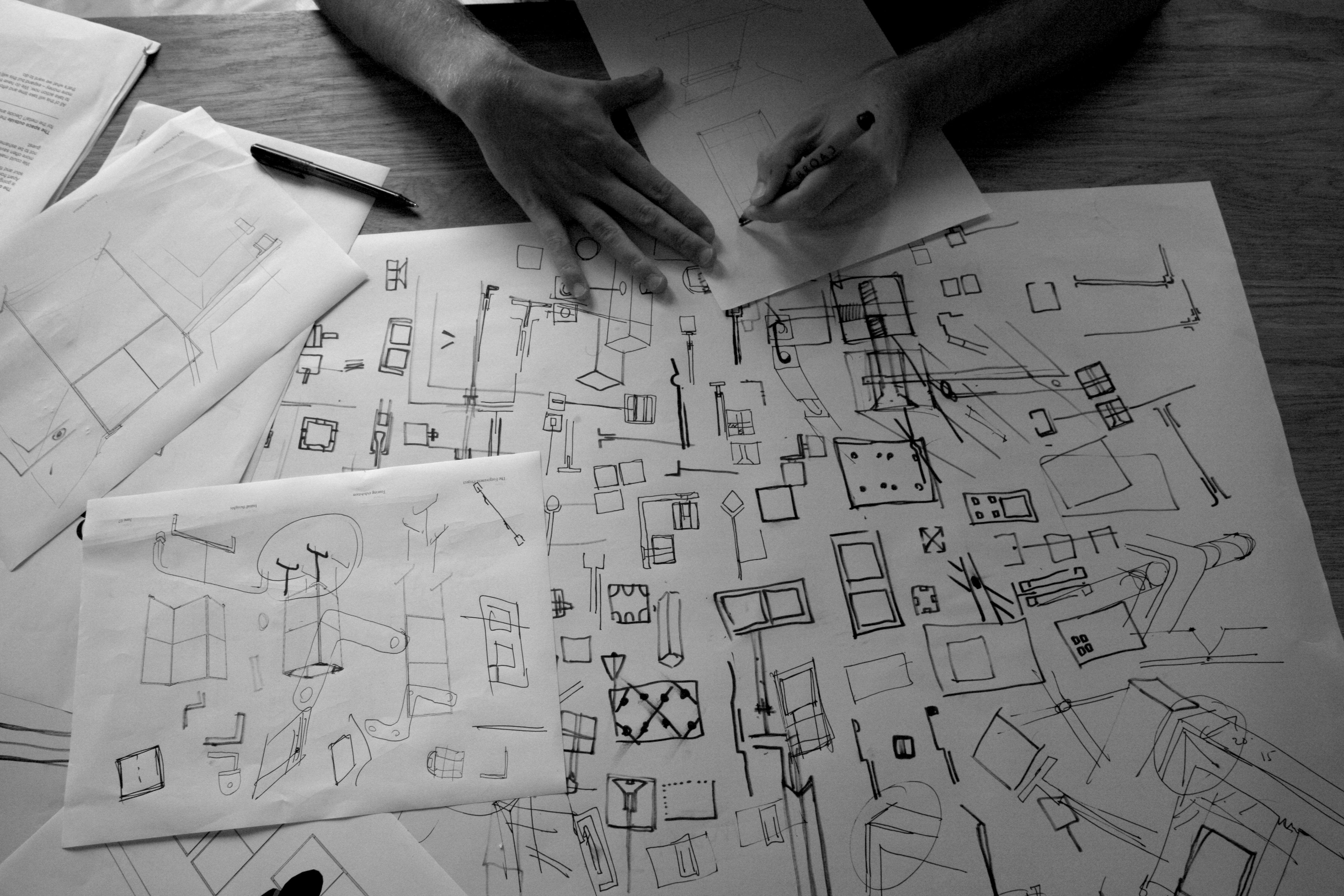 standard8 designer sketching designs on paper