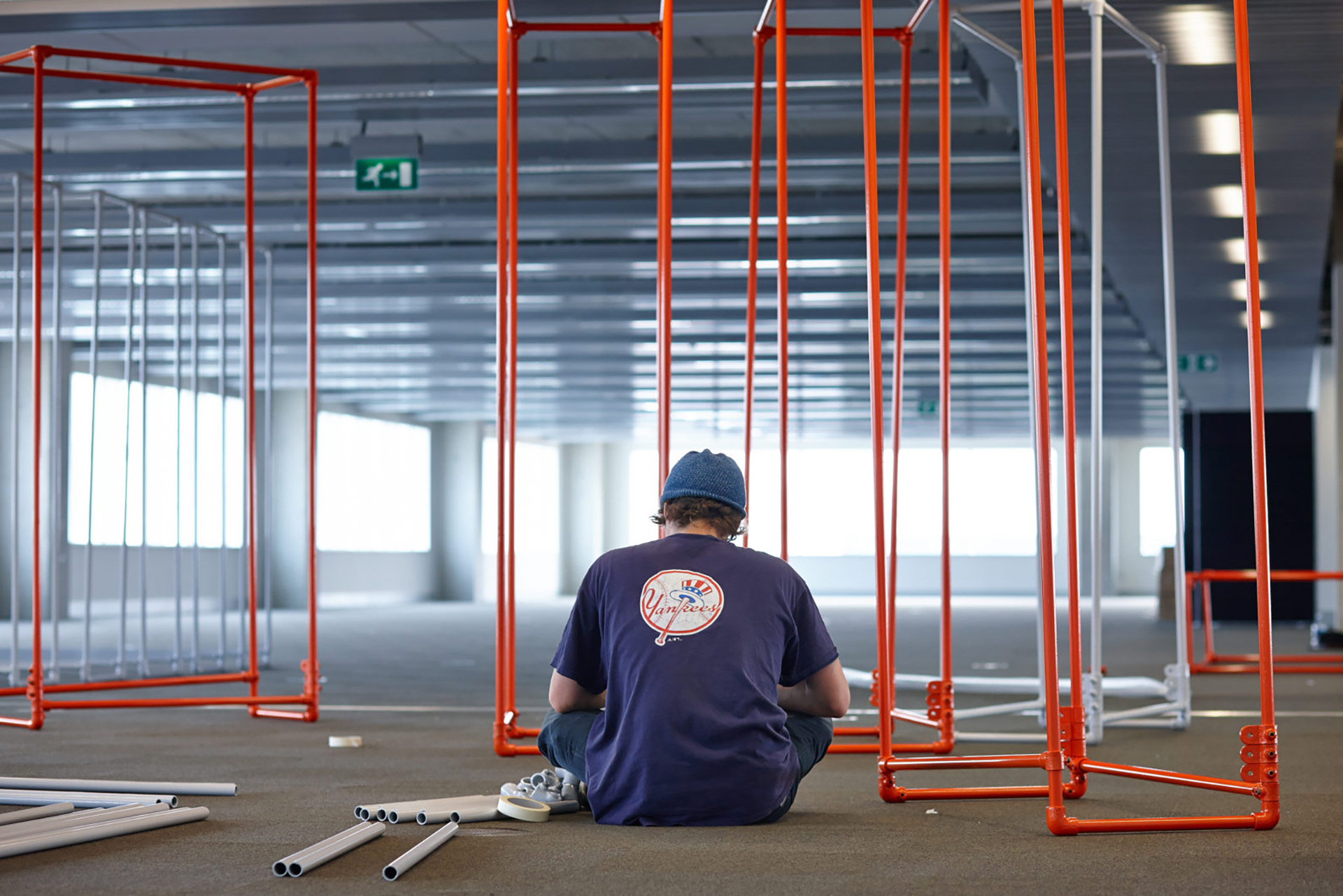 Standard8 team member installing exhibition frame work