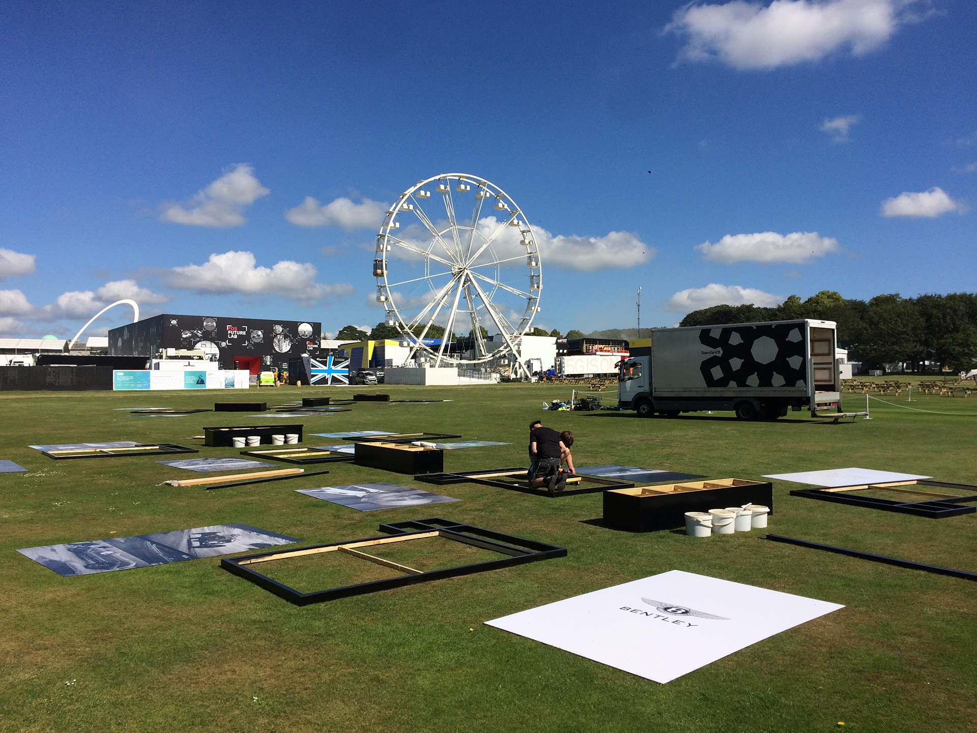 Standard8 team installing outdoor exhibition at Goodwood or the Festival of Speed