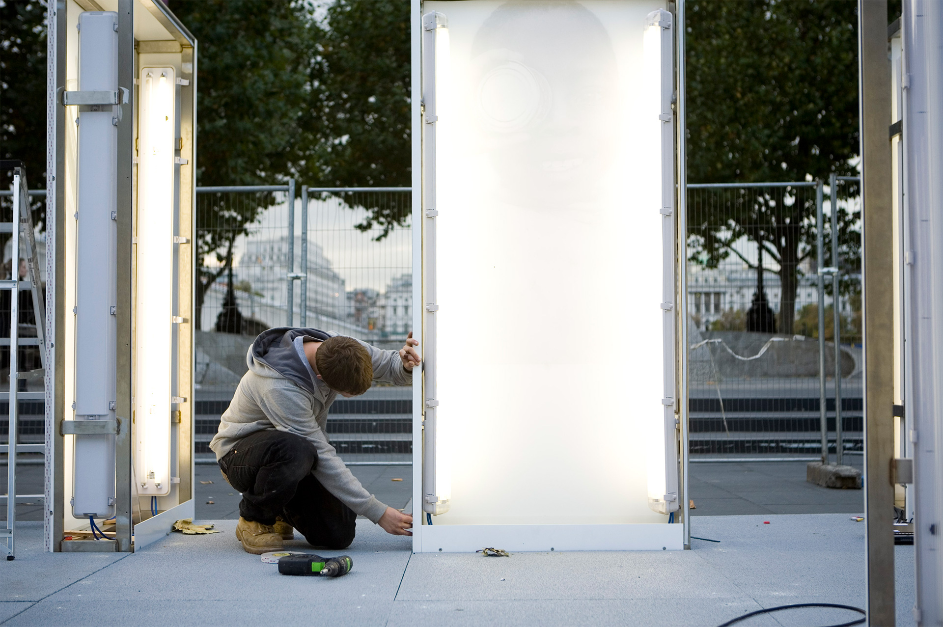 Standard8 team member installing a photo display light box at National Theatre London