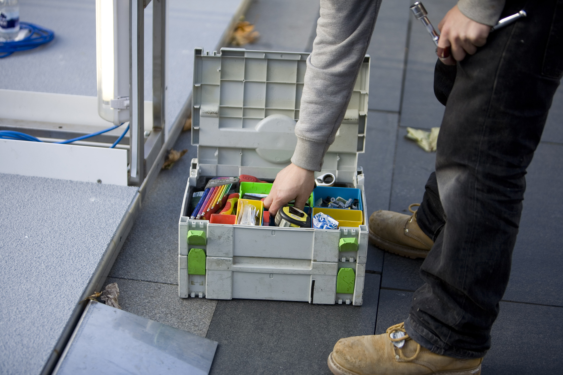 standard8 installation team member on site with tool box